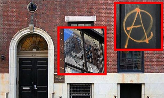 Vandals threw a brick through a front window, glued door locks, damaged a keypad, and spray-painted anarchy symbols on a New York Republican Party supporters' club. (Help repair our Club/GoFundMe)