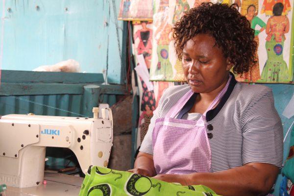 Peninah Mueni at her tailoring shop in Mukuru slums, Nairobi, Kenya.