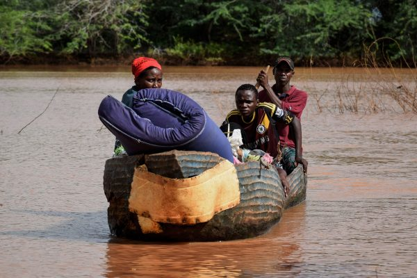 People move with their belongins on a boat in Kenya.