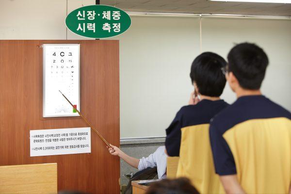 Young South Korean men take eye sight exams.