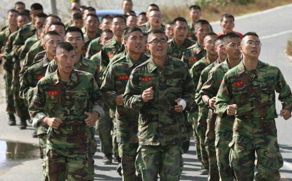 South Korean soldiers take a training run.