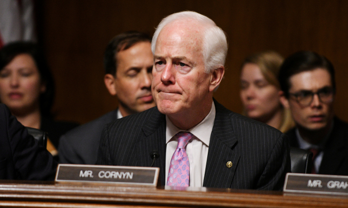 Sen. John Cornyn, R-TX reacts to Sen. Jeff Flake's R-AZ remarks during Senate Judiciary Committee meeting to vote on the nomination of Brett M. Kavanaugh to be an associate justice of the Supreme Court of the United States.in Washington, U.S., September 28, 2018.      REUTERS/Mary F. Calvert