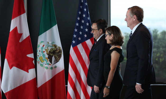 (L-R) Mexico's Secretary of Economy Ildefonso Guajardo Villarreal, Canada's Minister of Foreign Affairs Chrystia Freeland, and United States Trade Representative Robert E. Lighthizer gather for a trilateral meeting at Global Affairs on the final day of the third round of the NAFTA renegotiations in Ottawa, Ontario, on Sept. 27, 2017. (LARS HAGBERG/AFP/Getty Images)