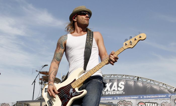 "File photo showing Todd Harrell, founding member and former bassist of the band ""3 Doors Down,"" performing in Fort Worth, Texas, on April 9, 2011. (AP Photo/Tim Sharp)"