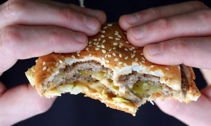 A man holds a burger purchased from a fast-food outlet on Jan. 7, 2013, in Bristol, England. (Matt Cardy/Getty Images)