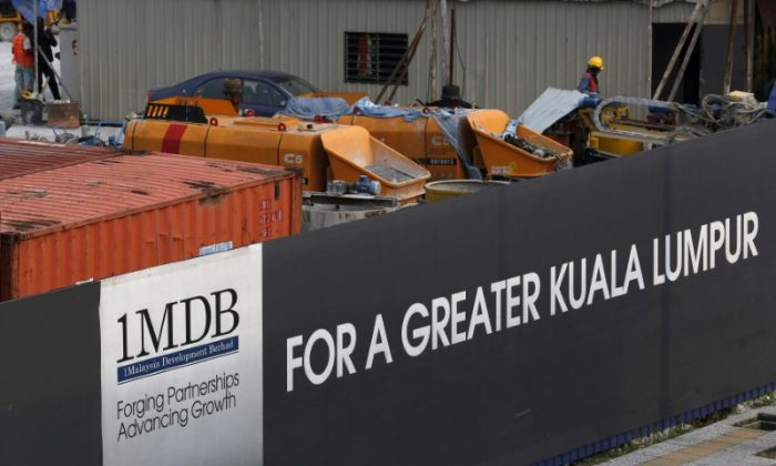Workmen are pictured on site at the 1Malaysia Development Berhad (1MDB) flagship Tun Razak Exchange development in Kuala Lumpur, Malaysia, on March 1, 2015.   (Olivia Harris/Reuters)