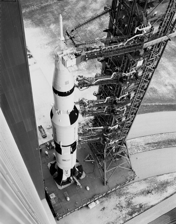 Apollo 6 and its gantry leaving the vehicle assembly building (VAB) on transporter heading to the launch site on pad 39A at KSC on Feb. 6, 1968. (NASA)
