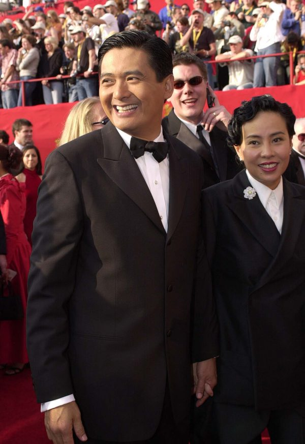 Actor Chow Yun Fat (L) arrives with his wife Jasmi