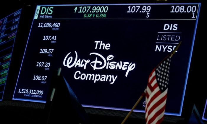 A screen shows the logo and a ticker symbol for The Walt Disney Company on the floor of the New York Stock Exchange in New York on Dec. 14, 2017. (Brendan McDermid/Reuters)