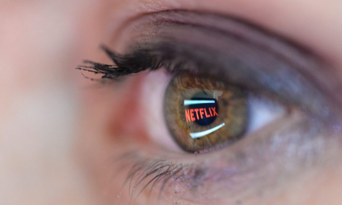 In this photo illustration the Netflix logo is reflected in the eye of a woman on Sept. 19, 2014 in PARIS, France. (Pascal Le Segretain/Getty Images)