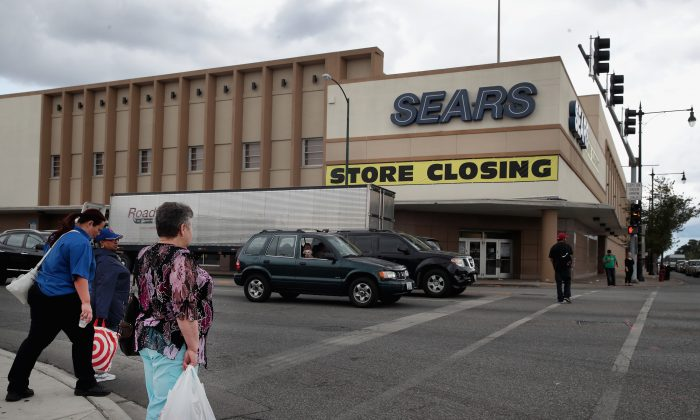 A sign announcing the store will be closing hangs above a Sears store in Chicago on Aug. 24, 2017. (Scott Olson/Getty Images)