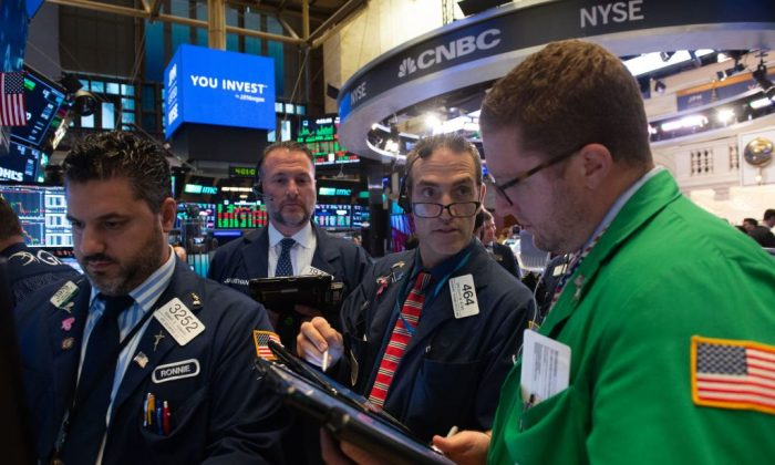 Traders work on the floor at the New York Stock Exchange in New York, on Sept. 12, 2018. (BRYAN R. SMITH/AFP/Getty Images)