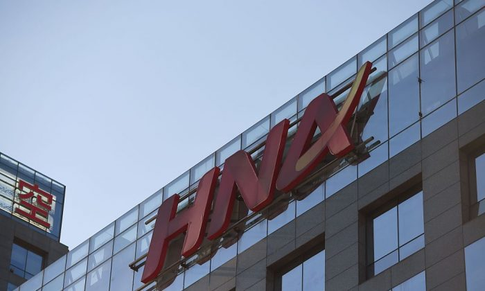 The HNA logo is seen on a building in Beijing on Feb. 18, 2016. (Greg Baker/AFP/Getty Images)