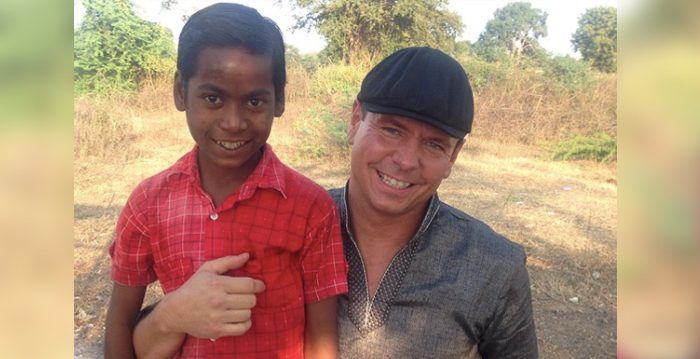 Jerry Hughes with a boy he met through the Wheels of Hope program in India. (Courtesy of Jerry Hughes)