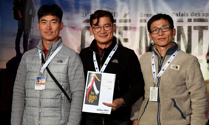 South-Korean mountaineer Kim Chang-ho (C), who died during a snowstorm in the Himalayas on Oct. 11, poses for pictures with other mountaineers ahead of an awarding ceremony in Grenoble, France, on Nov. 8, 2017. (Jean-Pierre Clatot/AFP/Getty Images)