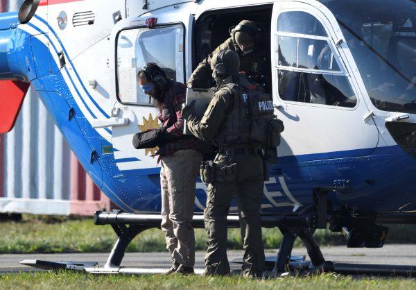 Moroccan Mounir el-Motassadeq is escorted at Hamburg airport