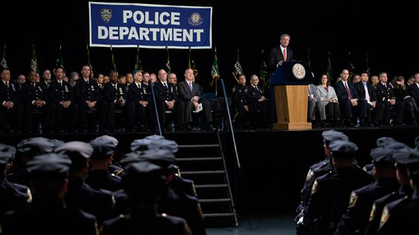 New York City Mayor Bill de Blasio speaks to the newest members of the New York City Police Department at their police academy graduation ceremony at the Theater at Madison Square Garden, October 15, 2018. (Drew Angerer/Getty Images)