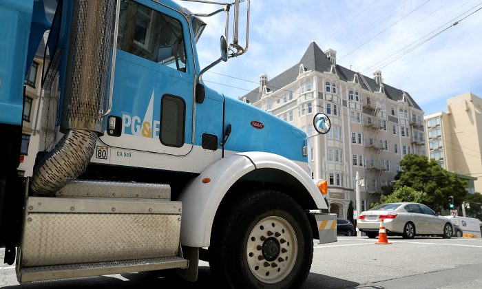 A  Pacific Gas and Electric (PG&E) truck sits parked on a street on June 18, 2018 in San Francisco, California. California lawmakers are saying that PG&E is considering bankruptcy after a report released by Cal Fire investigators earlier this month showed that PG&E was tied to 12 California wildfires in 2017 that destroyed thousands of homes and killed dozens of people. The fires could cost PG&E over $15 billion in fines and related liabilities.  (Justin Sullivan/Getty Images)