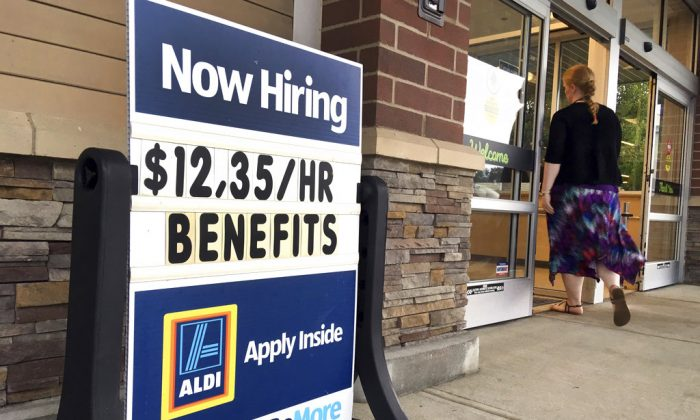 "A sign outside a business in Salem, N.H. says ""Now Hiring."" On  Oct. 16, the Labor Department reports on job openings and labor turnover for August. (AP Photo/Elise Amendola, File)"