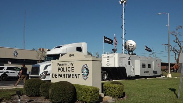 Verizon mobile truck in front of the Panama City Police Department
