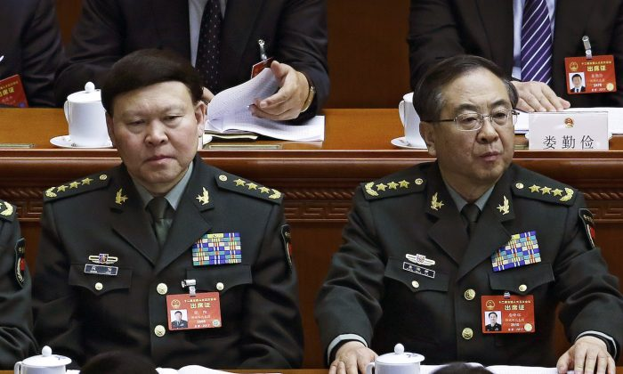 Zhang Yang (left), the then-head of China's People's Liberation Army (PLA) political affairs department, and Fang Fenghui (right), the then-chief of the general staff of the Chinese People's Liberation Army attend China's National People's Congress (NPC) at the Great Hall of the People in Beijing on March 8, 2017. (Andy Wong/AP)
