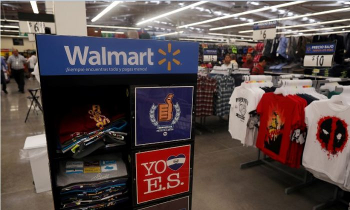 Clothes are displayed during the opening of a new Walmart Store in San Salvador, El Salvador, Aug. 21, 2018. (Reuters/Jose Cabezas)