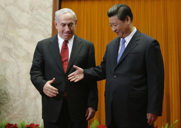 China's President Xi Jinping (R) shakes hands with Israel's Prime Minister Benjamin Netanyahu at the Great Hall of the People on May 9, 2013 in Beijing, China. (Kim Kyung-Hoon-Pool/Getty Images)