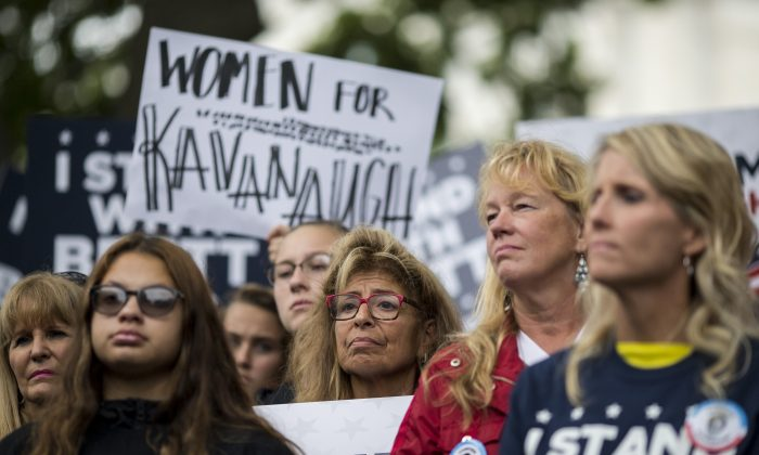 "Demonstrators held a rally to support Supreme Court Nominee Brett Kavanaugh on Sept. 27, 2018 in Washington, DC. A feminist writer has labeled the women who supported Kavanaugh as ""gender traitors,"" an example of tribalism encouraged by Democrats. (Zach Gibson/Getty Images)"