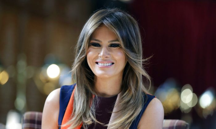 First Lady Melania Trump takes a seat during a visit to The Royal Hospital Chelsea in central London on Jul. 13, 2018. (Luca Bruno/AP Photo, Pool)