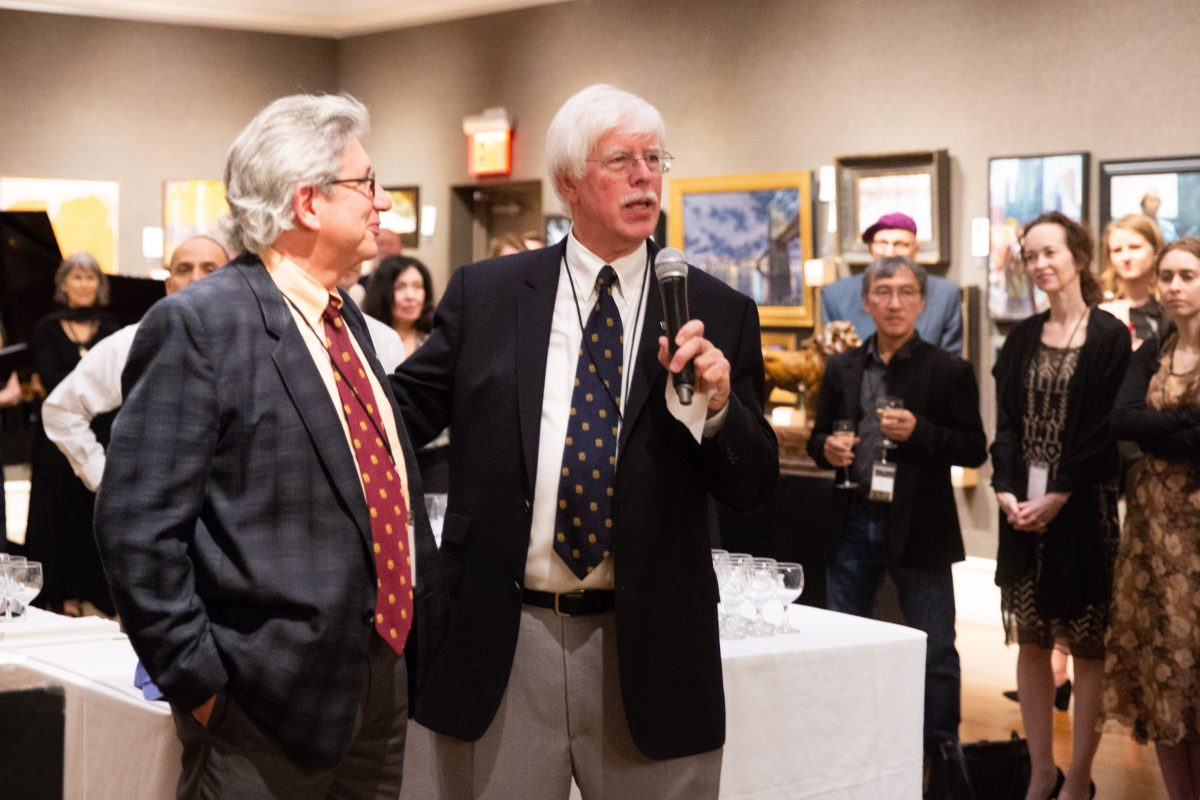 Art collector and Chairman of the Board of the Salmagundi Club, Tim Newton (R) with his friend, the artist, Del-Bourree Bach, give remarks at the opening of the American Masters Gala & Sale in the Salmagundi Club's Main Gallery on October 12,2018. (Milene Fernandez/The Epoch Times)