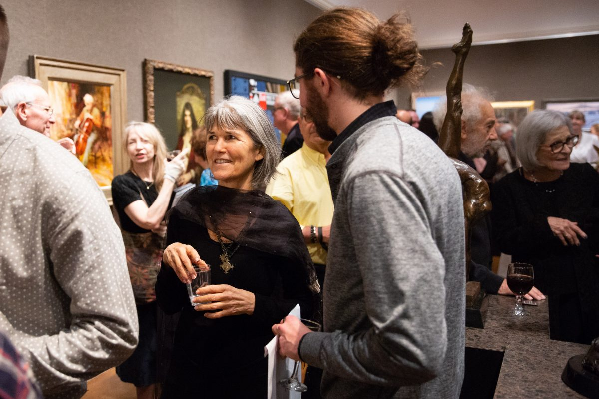Artist Sherrie McGraw (C) mingles duirng the American Masters Gala & Sale on October 12, 2018. (Milene Fernandez/The Epoch Times)