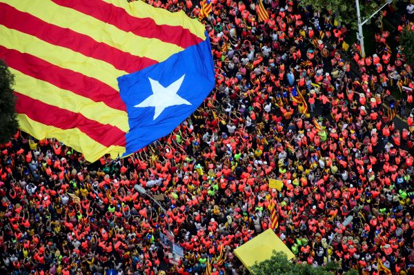 An aerial view of people holding a pro-independence Catalan flag.