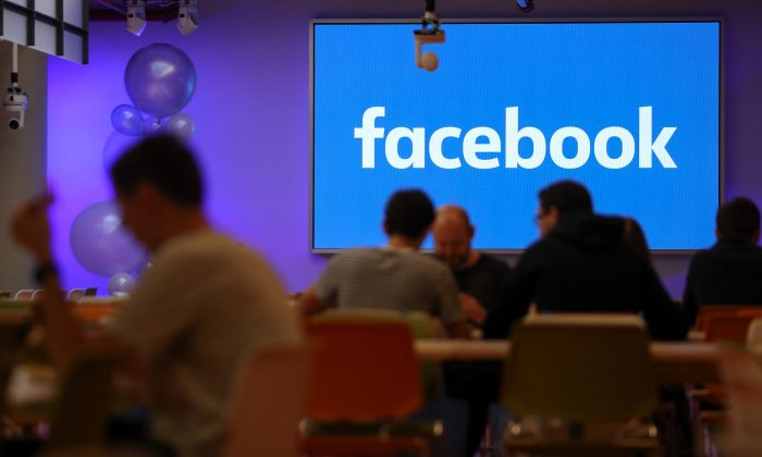 Employees have lunch at the canteen at Facebook's new headquarters in central London on Dec. 4, 2017. (Daniel Leal-Olivas/AFP/Getty Images)