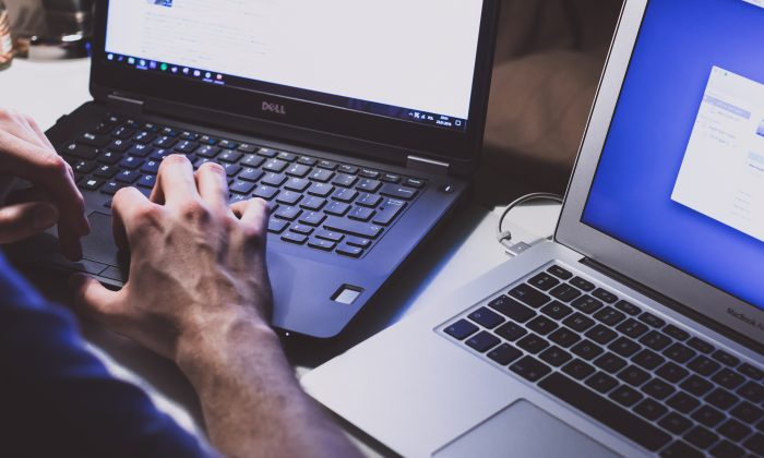 A man works on a laptop. (Unsplash)