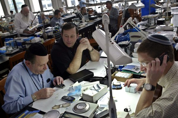 Diamond dealers put together a sale on the trading floor of the Israeli Diamond Exchange.