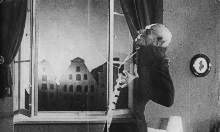"German actor Max Schreck (1879–1936), as the vampire Count Orlok, being destroyed by sunlight, in a still from F. W. Murnau's expressionist horror film ""Nosferatu, Eine Symphonie des Grauens,"" 1921. (Hulton Archive/Getty Images)"