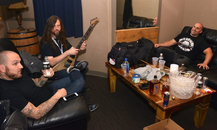 "Oli Herbert (center) and other members of the band ""All that Remains"" hangs out before their performance at the Freedom On Festival at the Grizzly Rose in Denver, Colorado, on Oct. 14, 2016. (Photo by Tom Cooper/Getty Images for Freedom On Festival)"