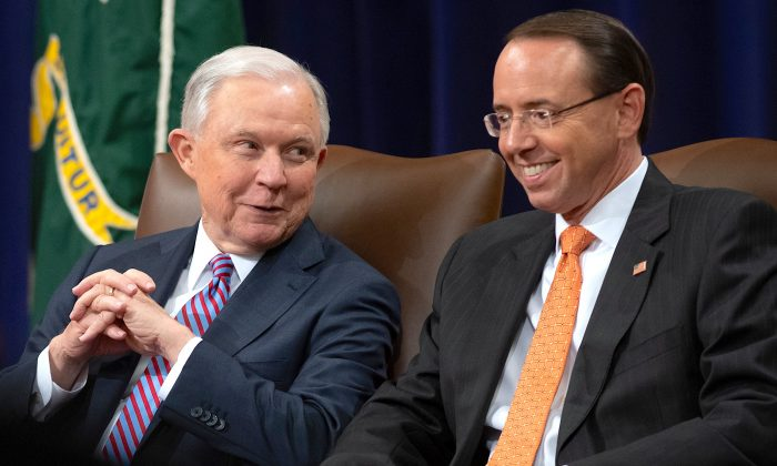 Attorney General Jeff Sessions and Deputy Attorney General Rod Rosenstein at the Department of Justice on Sept. 18, 2018. Sessions announced a broad crackdown on leaks in August last year. (SAUL LOEB/AFP/Getty Images)