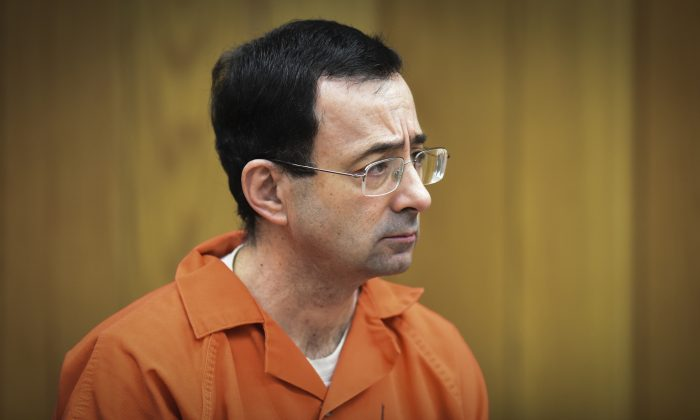 Larry Nassar, former sports doctor who admitted molesting some of the nation's top gymnasts, appears in Eaton County Court in Charlotte, Mich., on Oct. 17, 2018. (Matthew Dae Smith/Lansing State Journal/AP)