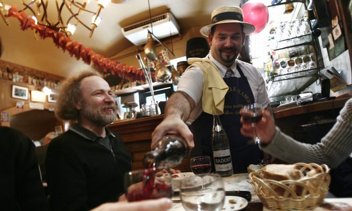 Restaurant patrons enjoy wine in a restaurant in Lyon, France, in this file photo. (Fred Dufour/AFP/Getty Images)