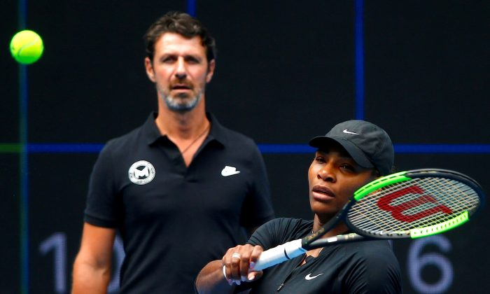 Serena Williams of the U.S. hits a shot as her coach Patrick Mouratoglou looks on during a training session ahead of the Australian Open tennis tournament in Melbourne, Australia, on Jan. 11, 2017. (David Gray/Reuters)