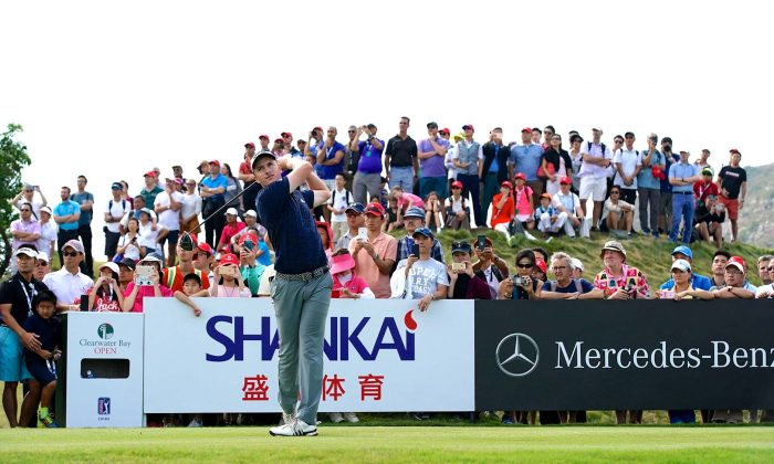 NIck Voke of New Zealand tees off from the 18th on his final round at the Clearwater Bay Golf Club on Sunday Oct 14 five shots clear of the field. Although under pressure to finish ahead of Callum Tarren he birdied the last to secure a lead of 3 shots to take his 3rd series title. (PGA TOUR Series-China / Zhuang Liu)