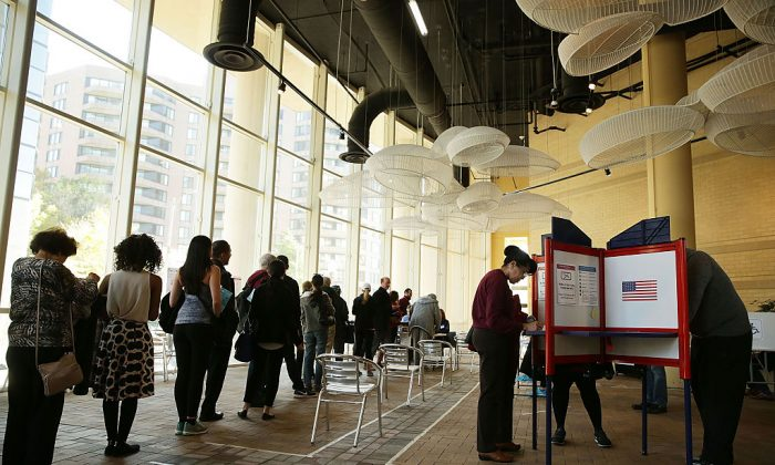 Voters wait in line to cast their ballots in a polling place on Election Day on Nov. 8, 2016 in Arlington, V.A.. (Alex Wong/Getty Images)