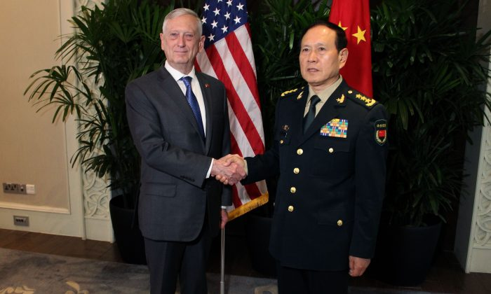 U.S. Defense Secretary Jim Mattis shakes hands with his Chinese counterpart General Wei Fenghe during a meeting on the sidelines of the Association of Southeast Asian Nations (ASEAN) security summit in Singapore on Oct. 18, 2018. (Thomas Watkins / AFP/Getty Images)