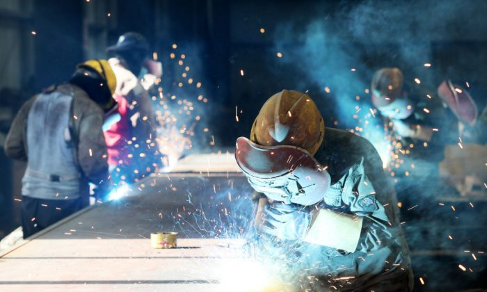 Workers cut steel at a factory in Huaibei, a city in eastern China's Anhui Province, on May 3, 2018. (AFP/Getty Images)