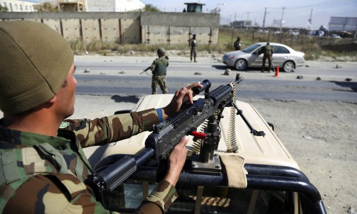 Afghan National army soldiers search a car at a checkpoint ahead of parliamentary elections scheduled for Oct. 20, at the Independent Election Commission compound in Kabul, Afghanistan, Wednesday, Oct. 17, 2018. (AP Photo/Rahmat Gul)