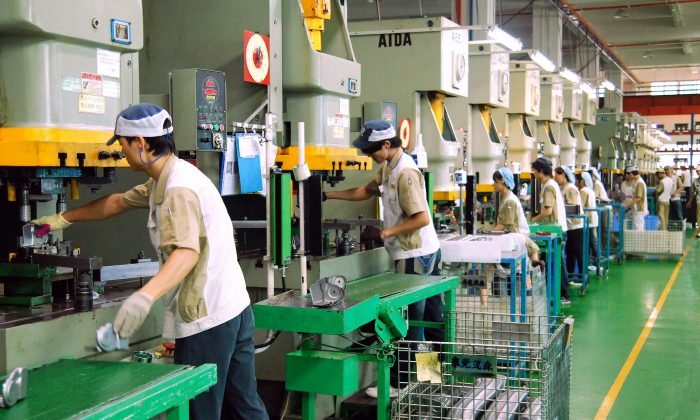 Chinese workers produce various components at the Mansfield Manufacturing plant in Dongguan, southern China's Guangdong province on October 20, 2008. At least 2.7 million factory workers in southern China could lose their jobs as the global economic crisis hits demand for electronics, toys and clothes, as the region has seen massive export-driven expansion in recent years by supplying the world with cheap consumer goods, but rising production costs and falling US and European demand have marked a swift end to the boom.       AFP PHOTO (Photo credit should read STR/AFP/Getty Images)