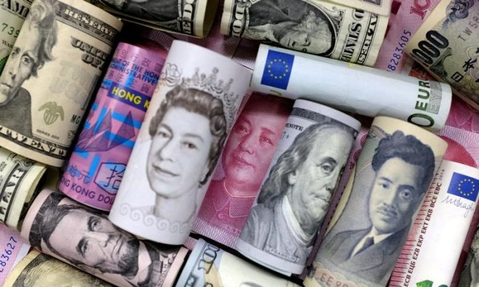 Euro, Hong Kong dollar, U.S. dollar, Japanese yen, pound, and Chinese 100 yuan banknotes are seen in this picture illustration on Jan. 21, 2016. (Jason Lee/Illustration/Reuters)