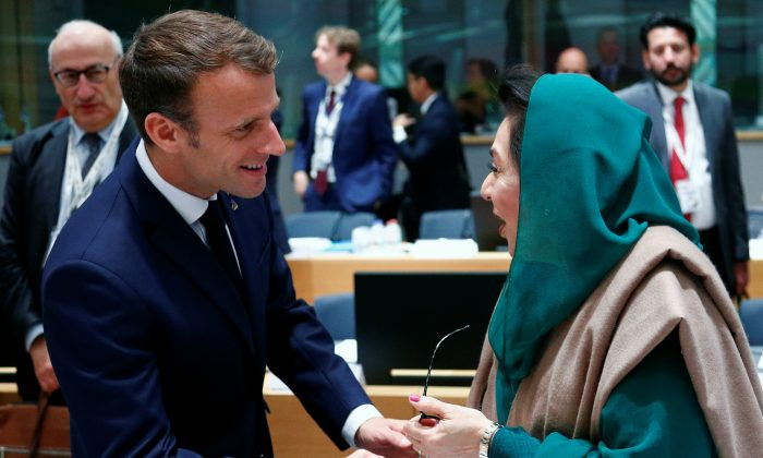 French President Emmanuel Macron and Pakistan's Federal Minister for Inter Provincial Coordination Fehmida Mirza shake hands as they attend the ASEM leaders summit in Brussels, Belgium, on Oct. 19, 2018. (Francois Lenoir/Reuters)