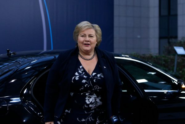 Norway's Prime Minister Erna Solberg gets out of a car